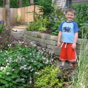 """Whenever Isaac helped me in the garden he would always chant """"working hard, having fun!"""""""